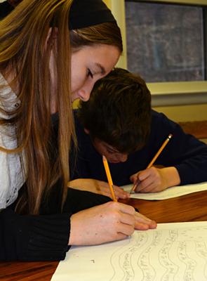 Students Practice Writing Skills at Divinum Auxilium Academy