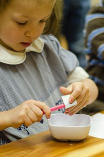 Student Sharpens Pencil at Divinum Auxilium Academy